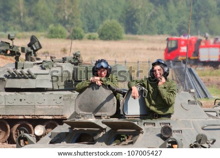 ZHUKOVSKY, RUSSIA - JULY 1: two tankmen sit in their vehicle after the show on the Forum ET-2012 on July 01, 2012 in Zhukovsky, Russia