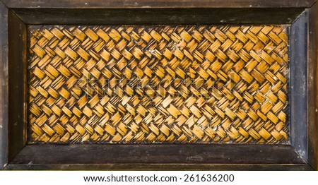 Zigzag interlocking of handcraft bamboo weave texture natural wicker background on wood frame - stock photo