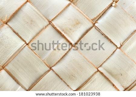 Zigzag interlocking of palm leaves - stock photo