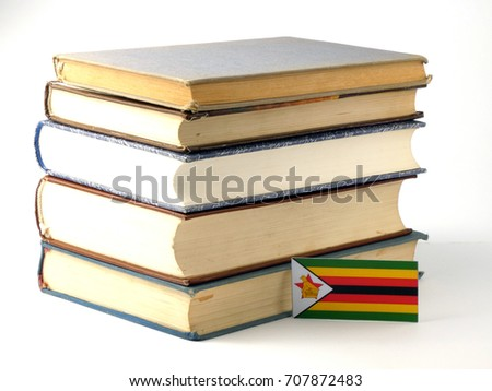 Zimbabwe flag with pile of books isolated on white background