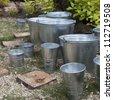 zinc bucket of water standing - stock photo