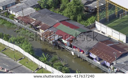 Zinc home on dirty canal in Bangkok, Thailand