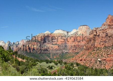 Zion National Park scenic in horizontal format with blue cloudy sky.