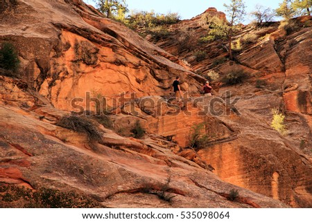 ZION NATIONAL PARK, UT - MARCH 30: Hikers pause for photographs along the popular but strenuous Hidden Canyon Trail March 30, 2016 in Zion National Park, UT.