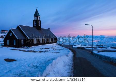 Zion's Church in Ilulissat, with midnight sun light, North Greenland - stock photo