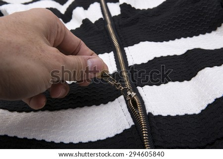 zipper in the black cloth and white - stock photo