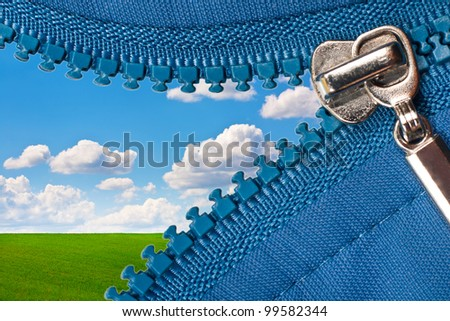 zipper of a camping tent with landscape background - stock photo