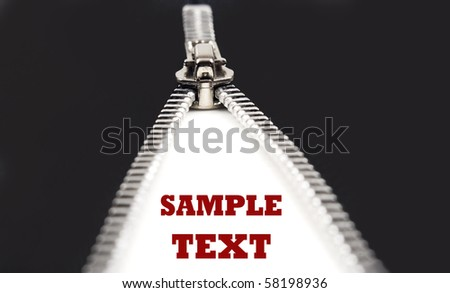 Zipper on a black surface with space for text - stock photo
