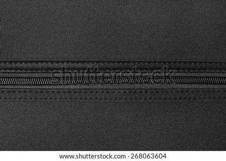 zipper on black material fabric - stock photo