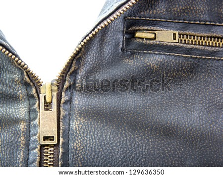 Zipper on brown leather motorcycle jacket. - stock photo