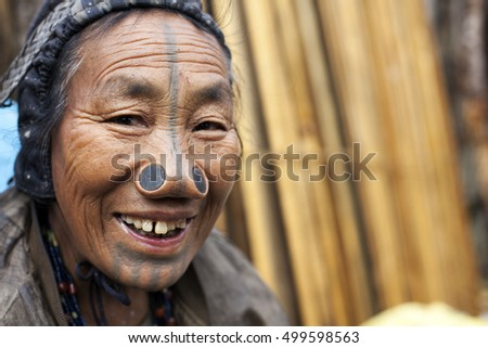 ZIRO, ARUNACHAL PRADESH/INDIA - DECEMBER 13, 2013: Woman of the Apatani tribe, with nose plugs, The Apatani are a tribal group of people living in the Ziro valley in Arunachal Pradesh, India.