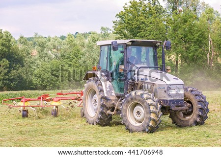 ZLATAR BISTRICA, CROATIA - JUNE 22, 2016: Lamborghini R4.105 tractor on the field. The model is built in Italy and features a 110 hp (82 kW) Deutz engine.