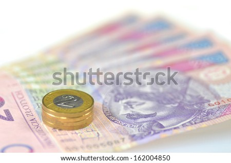 zloty banknotes and coins from poland - stock photo