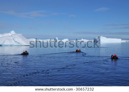 Zodiac cruise in Antarctica - stock photo