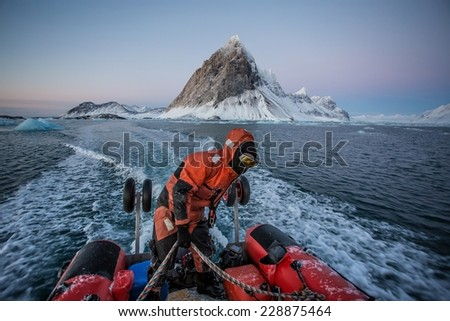 Zodiac cruise in the Arctic fjord - between glaciers, icebergs and mountains - stock photo