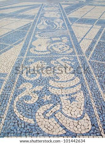 "Zodiac Signs . Black and white stone mosaic ""calcada"" pavement in Lisbon,  Portugal - stock photo"