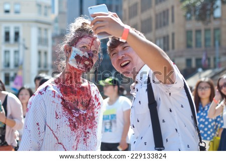 Zombie at Sydney Zombie Walk in Sydney, AU, 1st November, 2014. The Sydney Zombie Walk is an annual event where thousands of people get involved to raise awareness for Australias Brain Foundation. - stock photo