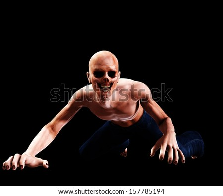 Zombie crawling on the floor. - stock photo