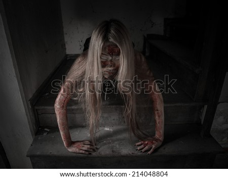 Zombie girl in haunted house scary - stock photo