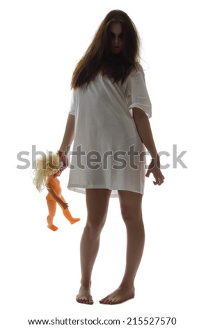 Zombie girl with doll isolated - stock photo