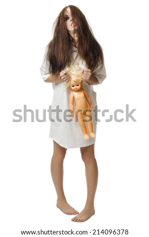 Zombie girl with doll isolated on white - stock photo