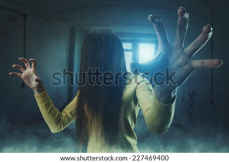 Zombie girl with long hair - stock photo