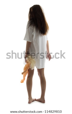 Zombie girl with plastic doll - stock photo