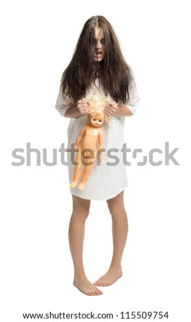 Zombie girl with plastic doll isolated - stock photo
