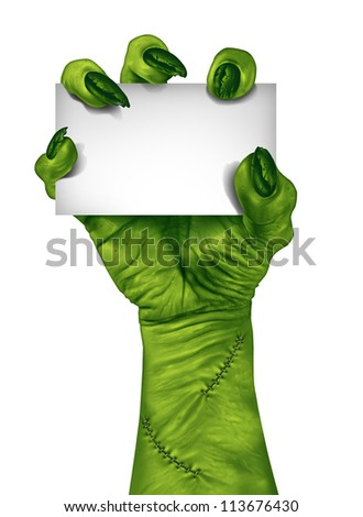 Zombie hand holding a blank sign card as a creepy halloween or scary symbol with textured green skin wrinkled monster fingers and stitches isolated on a white background.. - stock photo