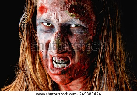 zombie isolated in black background - stock photo