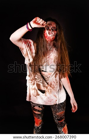 zombie isolated in dark background - stock photo
