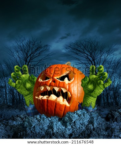 Zombie pumpkin halloween greeting card with copy space as a scary surprise creepy jack o lantern with monster green hands rising from the dead on a dark cold haunted autumn night. - stock photo