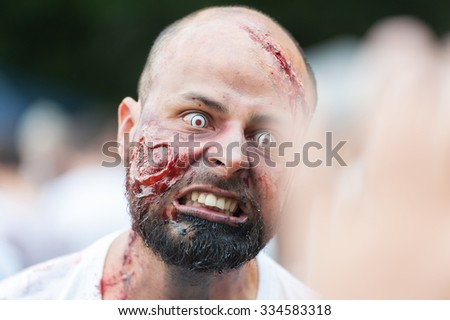 Zombie scares at Sydney Zombie Walk in Sydney, AU, 31st October, 2015. Zombie Walk is an annual event where thousands of people get involved to raise awareness for Australia's Brain Foundation. - stock photo