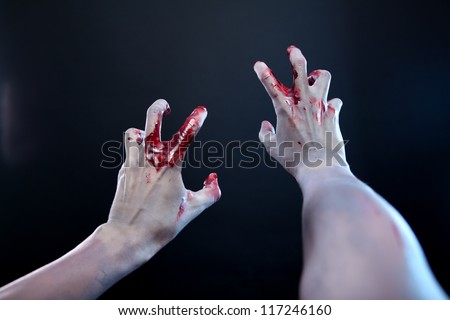 Zombie stretching bloody hands, first person point of view - stock photo