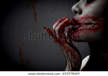 Zombie woman death the ghost horror drain hand blood skin is screaming darkness and nightmare background of scary fear on hell is monster devil girl in halloween festival concept,copy space the left.