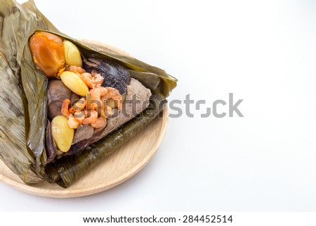 Zongzi or sticky rice dumpling have space on left side, white background - stock photo