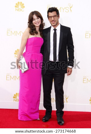 Zooey Deschanel and Jacob Pechenik at the 66th Annual Primetime Emmy Awards held at the Nokia Theatre L.A. Live in Los Angeles on August 25, 2014 in Los Angeles, California. - stock photo