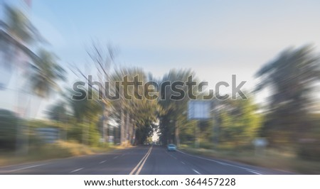 Zoom blur high speed motion in the countryside road  for abstract background. - stock photo