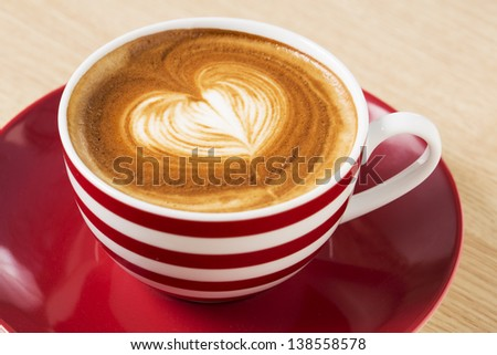 Zoomed coffee cup with boom and foam illustration - stock photo