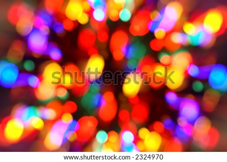 Zooming out on out-of-focus Christmas lights to give it a feeling of movement and motion