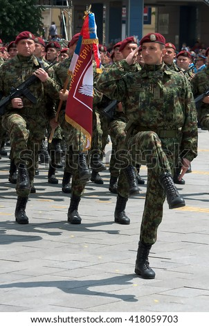 ZRENJANIN - MAY 9th:Serbian Army Special Brigade with brigade flag on Celebration a Victory Day and the Day of the Army of Serbia.May 9,2016 in Zrenjanin, Serbia