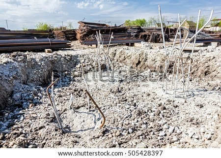 Zrenjanin, Vojvodina, Serbia - April 24, 2015: Skeleton of reinforcing steel, armature, bar at construction site is buried into ground filed with concrete.