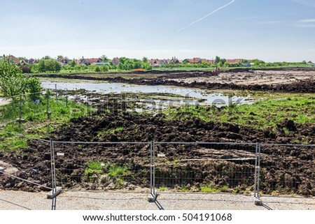 Zrenjanin, Vojvodina, Serbia - July 5, 2015: Landscape transform into urban area with machinery, people are working. View on construction site.