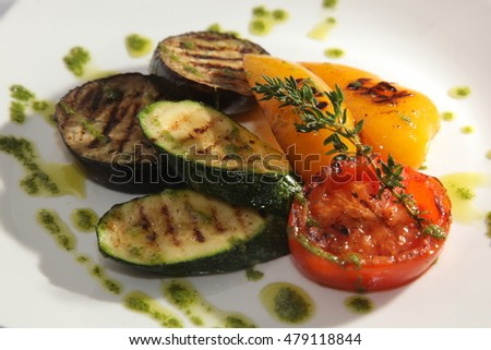Zucchini and grilled vegetables on plate