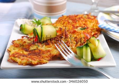 zucchini and potato pancakes served with herb cream cheese - stock photo