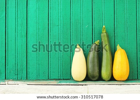 zucchini and vegetable marrows on green background - stock photo