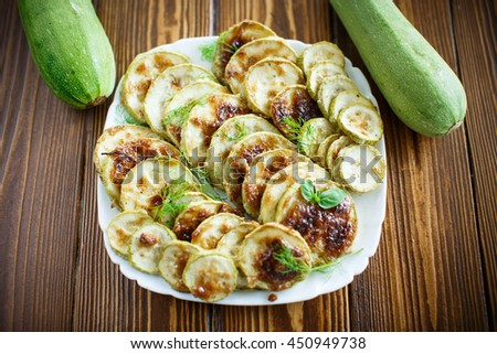 zucchini baked with sauce - stock photo