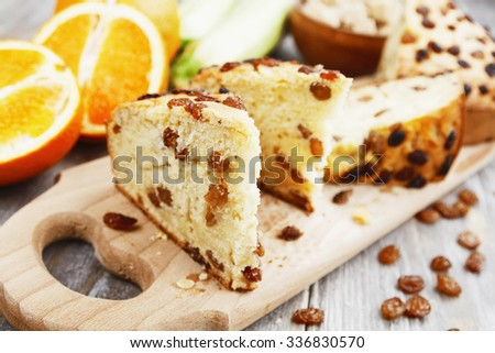 Zucchini cake with raisins and orange on the table