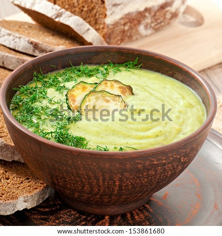 zucchini cream soup in a ceramic bowl - stock photo