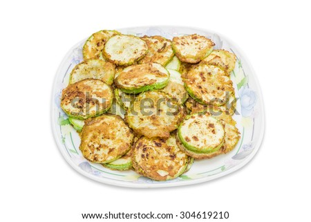 Zucchini, fried in batter on dish on a light background. Isolation.